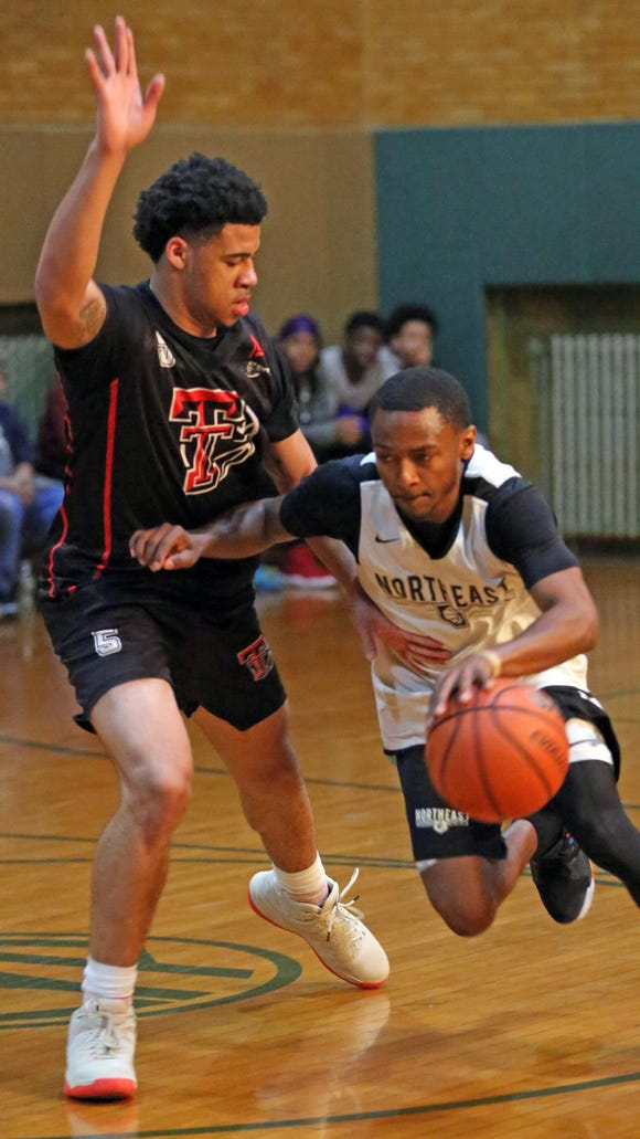 Blaze's Tyrese Williams (5) guards Northeast's Ja'Quay James (2) during basketball tournament at CYP Gym Our Lady of Mercy Church in Port Chester March 27, 2018.  Northeast beats the Blaze 73-62 to win the Sinis/Ciccone title.