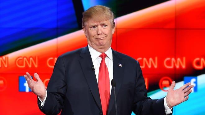 Donald Trump mocks a rival during the Dec. 15 Republican presidential debate.