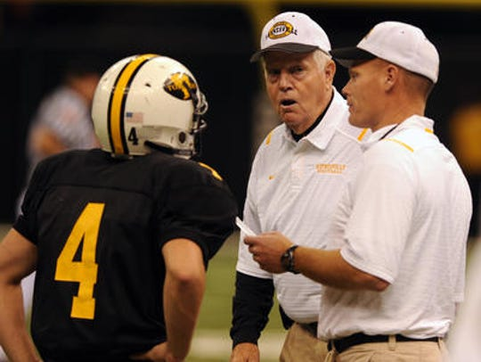 Haynesville coach David Franklin (right) gets help