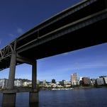 Portland is visible under the Interstate 5 Marquam Bridge on the Willamette River.