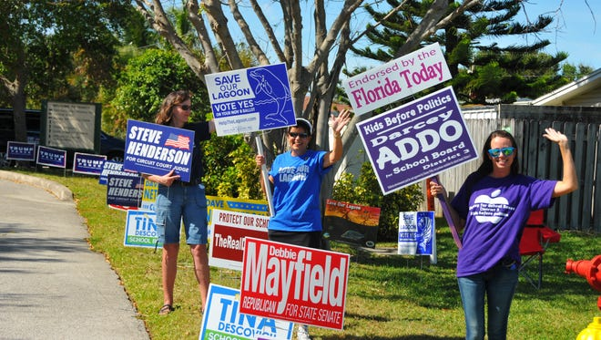 Supporters and sign wavers out in front of Trinity Wellspring Church in Satellite Beach.