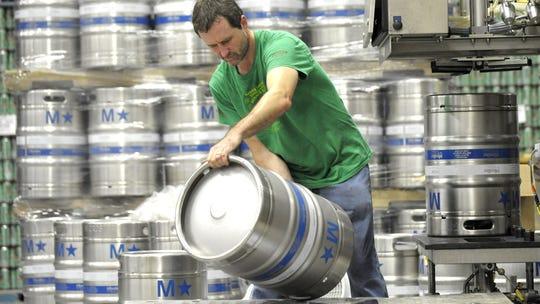 Brew Detroit brewer Ken Belau moves a full keg of Stroh's