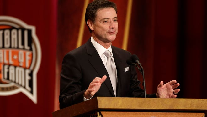 Inductee Rick Pitino speaks during the enshrinement ceremony for the 2013 class of the Naismith Memorial Basketball Hall of Fame at Symphony Hall in Springfield, Mass.