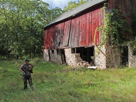 636513499143036707-Crossbow-hunter-in-WIsconsin-farm-landscape.jpg