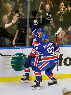 Rochester'sBrian Gionta celebrates his second period goal against Toronto. Gionta will go on to captain the US Olympic team.