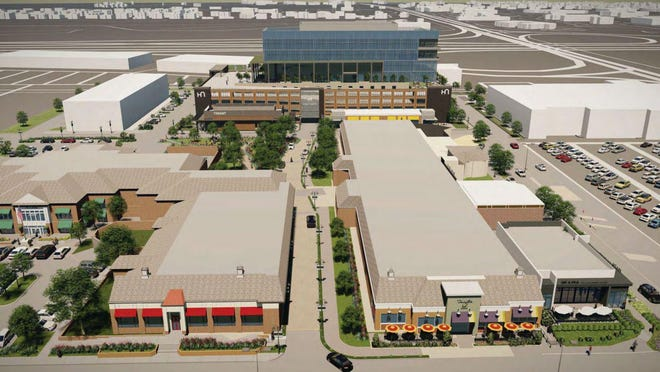 The owners of the Shops at Worthington Place propose demolishing much of the mall and replacing it with offices. This rendering shows the proposed first office building, on the north side of the property.