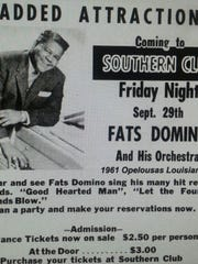A billboard advertises Fats Domino's 1961 performance at the Southern Club in Opelousas.