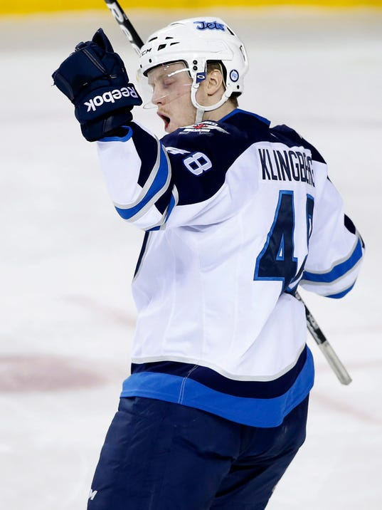 Winnipeg Jets' Carl Klingberg, from Sweden, celebrates his first NHL goal, against the Calgary Flames, during second period NHL action in Calgary, Alberta, Friday, April 11, 2014. (AP Photo/The Canadian Press, Larry MacDougal)