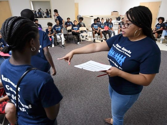 Shana Scott organizes work groups for the Summer Career Employment Academy run by Crispus Attucks. Students, ages 14 to 18, get four weeks of paid work experience.