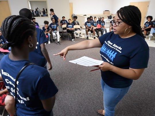 Shana Scott organizes work groups for the Summer Career