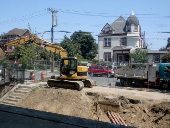 Construction workers put pipes in at Graham School
