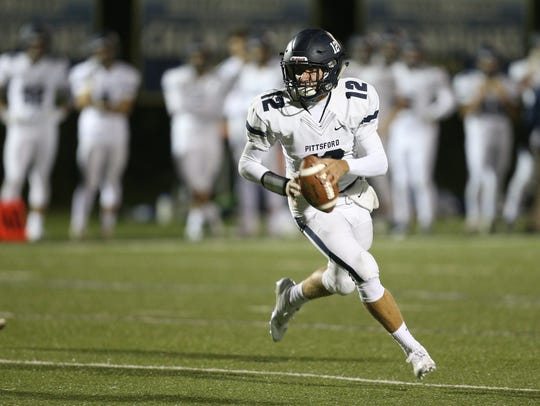 Pittsford quarterback Matt Larocca rolls to his left