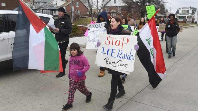 BAMN organizer Kate Stenvig, marches with supporters towards Schaefer Road in Dearborn on Saturday to bring awareness for immigrant rights.