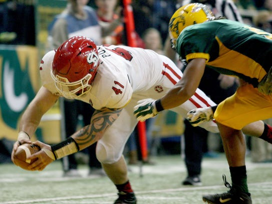 South Dakota back Drew Potter (41) lunges into the