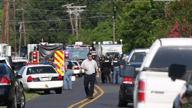 Emergency vehicles and responders line Pearl Street in southern Monroe, near the scene where two OPSO officers were shot and injured while attempting to deliver a felony warrant to Ricky Lavelle Wade at a home on Mary Beth Court in southern Monroe on Thursday. Wade has been identified as the suspect in the shooting and was apprehended in a home on Michelle Court.