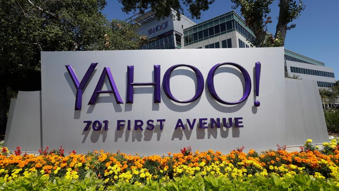Flowers bloom in front of a Yahoo sign at the company's headquarters Tuesday, July 19, 2016, in Sunnyvale, Calif.