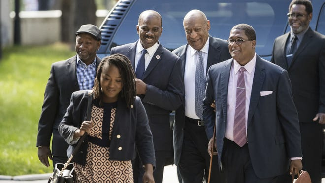 Bill Cosby, accompanied by Joe Torry, left, Lewis Dix, center left, and Cosby spokesman Andrew Wyatt, second right, arrives for Day 4 of his sexual assault trial in Norristown, Pa., June 8, 2017.