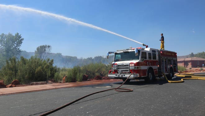 St. George Police and St. George Fire Departments respond to a brush fire on Snow Canyon Parkway on July 5, 2017.
