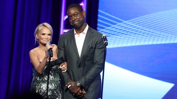 Kristin Chenoweth, left, and Sterling K. Brown surprised