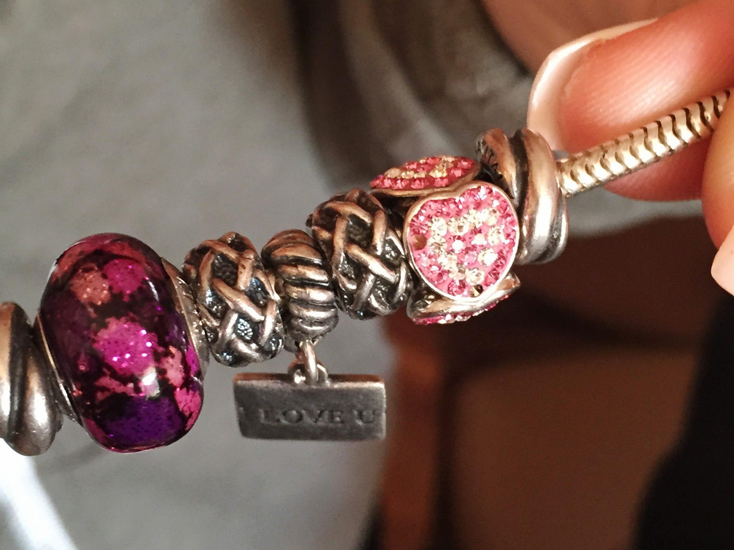 Brittany Hatfield holds a bracelet her ex-boyfriend,