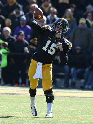 Nov 1, 2014; Iowa City, IA, USA; Iowa Hawkeyes quarterback Jake Rudock (15) looks to pass during the game against the Northwestern Wildcats at Kinnick Stadium. Mandatory Credit: Caylor Arnold-USA TODAY Sports