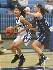 Cedar Crest's Ariel Jones brings the ball up the court
