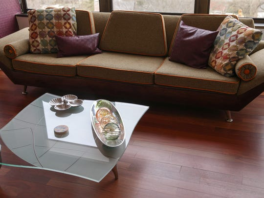 A reupholstered couch, and a high end coffee table