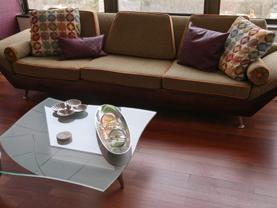 A reupholstered couch, and a high end coffee table found on deep discount, inside the home of Jenny Bizzoco and Hector Rosa, Tarkington Tower, Indianapolis, Sunday, February 26, 2017.
