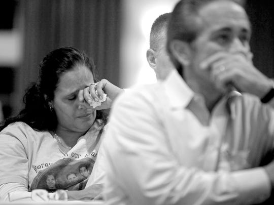 Families grieve during the Compassionate Friends' 23rd