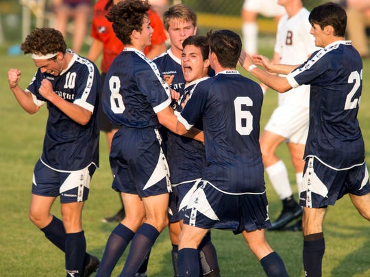 Teammates surround Farragut's Pablo Herrera after Herrera scores against Bearden in the first half of the 1-0 win in the District 4-AAA Semi-Finals at Bearden on Wednesday, May 9, 2017.