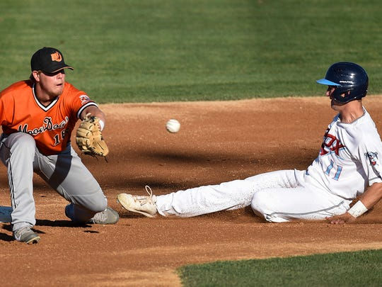 St. Cloud Rox player Drew Freedman, right, safely steals second base under the tag attempt by Mankato's Robbie Palkert in the first inning Saturday at Joe Faber Field.