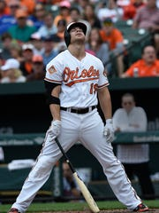 Three years ago on Wednesday, Chris Davis signed a monster deal with the Baltimore Orioles. His production since signing the contract has dropped markedly. AP FILE PHOTO