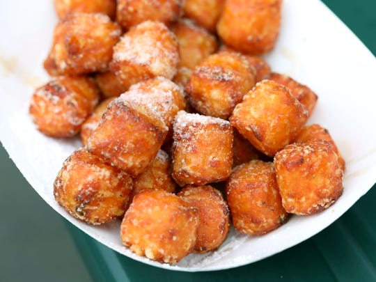 Sweet potato tots are topped with maple syrup and confectionary