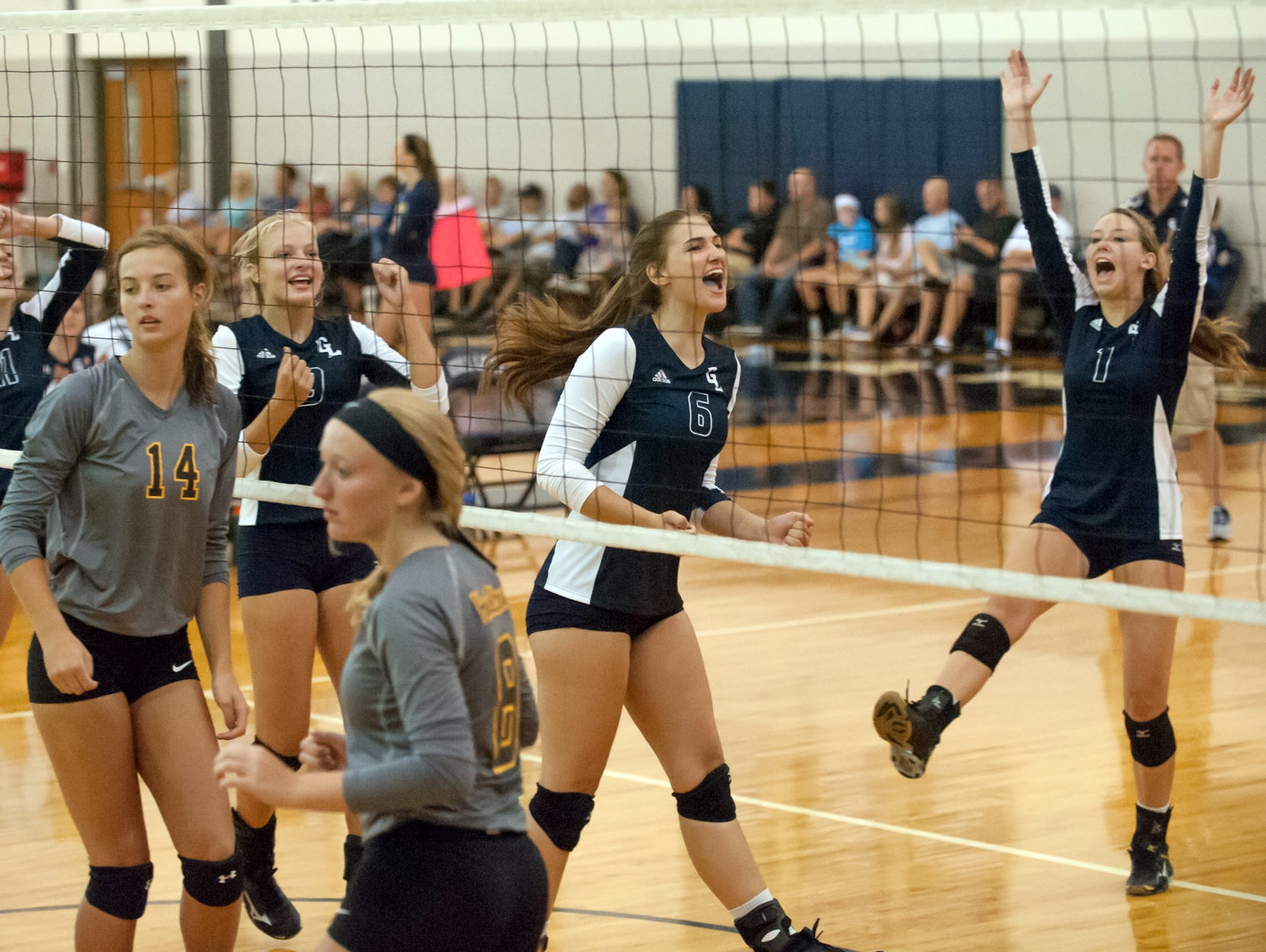 Gull Lake celebrates after a win during the Gull Lake Invitational on Friday.