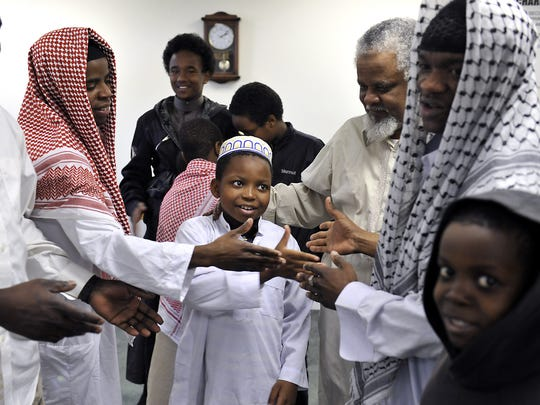 Worshippers greet each other with hugs and handshakes