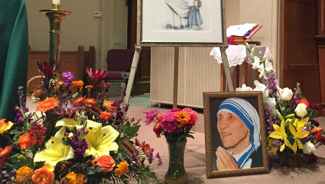 The altar at Holy Apostles Church on Lyell Avenue was decorated Sept.4 with images of Mother Teresa to celebrate her canonization.