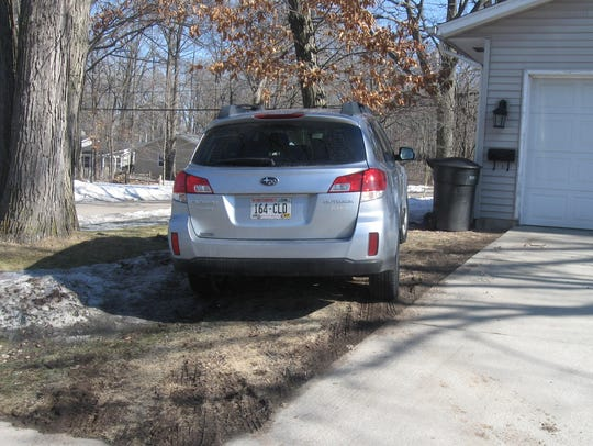 Appleton Inspection Supervisor Kurt Craanen says his office investigates complaints of cars parked on the grass.