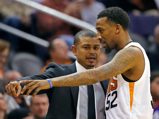 Phoenix Suns Interim head coach Earl Watson talks with guard Jordan McRae in the first  half of their loss to the Toronto Raptors on Tuesday, Feb 2, 2016 in Phoenix AZ.