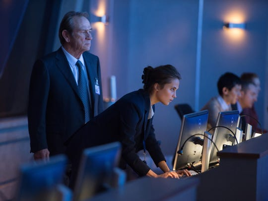 Tommy Lee Jones, left, and Alicia Vikander appear in
