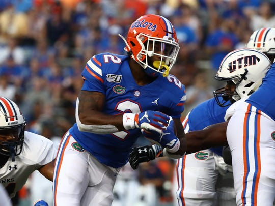 Sep 7, 2019; Gainesville, FL, USA; Florida Gators running back Lamical Perine (2) runs with the ball during the first quarter at Ben Hill Griffin Stadium. Mandatory Credit: Kim Klement-USA TODAY Sports