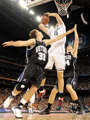 Butler guard Chase Stigall (33) and teammate Andrew Smith defend in the 2011 Final Four.