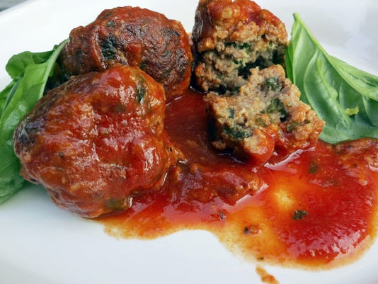 Homemade meatballs should be fork-tender, not tightly compacted. Use your hands to mix the meat and shape the meatballs, but don't overwork them.
