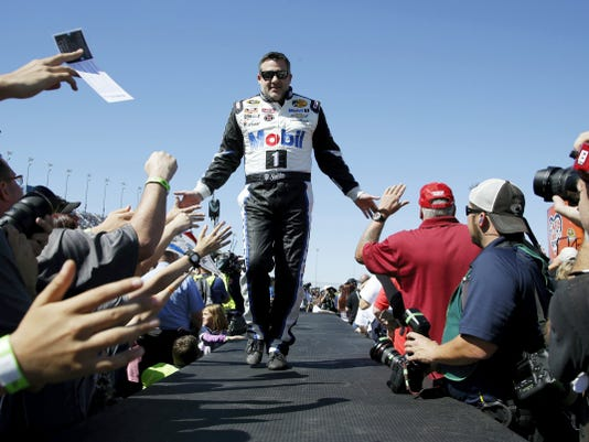 Tony Stewart greets fans during drivers introduction before a race at Chicagoland Speedway. Stewart is scheduled to announce Wednesday that he will retire after the 2016 season.