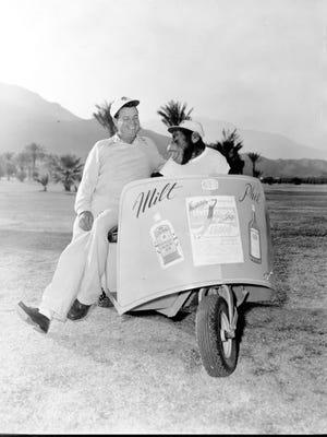 Milt Hicks 'Mr. Golf' in his Thunderbird Country Club golf cart.
