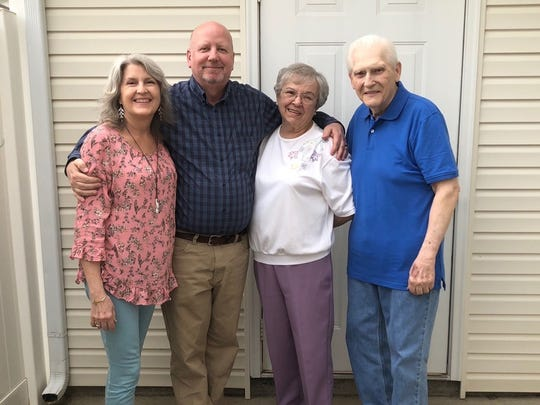 Sheri Morris, left, did the research that connected husband Brad, second from left, with his birth mother. Pictured are Carol and Darold Morris, who raised Brad from the time he was just a few days old.