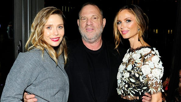 "(L-R) Elizabeth Olsen, Harvey Weinstein and Georgina Chapman attend The Weinstein Company with FIJI, Grey Goose, Lexus and NetJets host the after party for ""Wind River"" at The Skylark on August 2, 2017 in New York City."