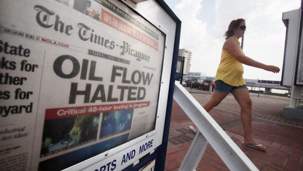 "NEW ORLEANS - JULY 16: The New Orleans Times-Picayune front page reads ""Oil Flow Halted"" July 16, 2010 in New Orleans, Louisiana. The cap sealing the BP oil well in the Gulf of Mexico has remained sealed during the 48-hour testing period offering a glimmer of hope in the disaster.  (Photo by Mario Tama/Getty Images)"