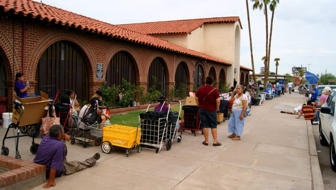 At times, more than 500 families line up outside the Church on Fillmore in Phoenix to take home food donations. The St. Mary's mobile food pantry sites focus on areas in the metro Phoenix area with a high population living in poverty.