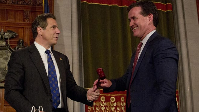 New York Gov. Andrew Cuomo, center, presents gavels to Assembly Speaker Carl Heastie, D-Bronx, left, and Senate Majority Leader John Flanagan, R-Smithtown, following a news conference in the Red Room at the Capitol on Thursday, June 25, 2015, in Albany, N.Y.
