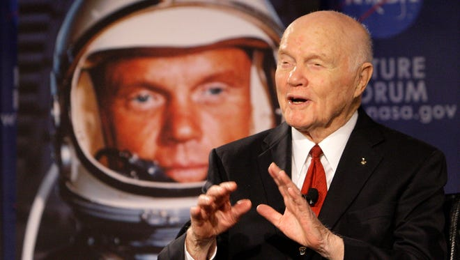 "Then Sen. John Glenn talks, via satellite, with the astronauts on the International Space Station, before the start of a roundtable discussion titled ""Learning from the Past to Innovate for the Future"" Feb. 20, 2012, in Columbus, Ohio."